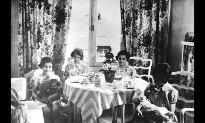 Before the German's invaded Anne Frank had a happy childhood. Here we see Anne (left), her sister Margot and their friends at a tea party in Amsterdam during 1934.