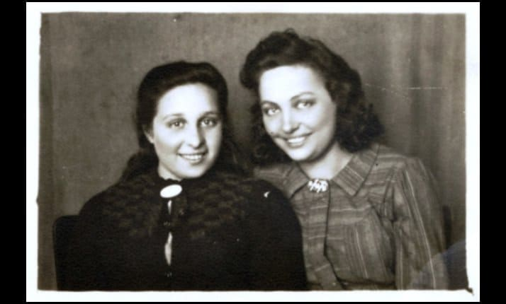 A post-war photograph of two Jewish women partisans who supported the Bielski brigade by transporting arms.