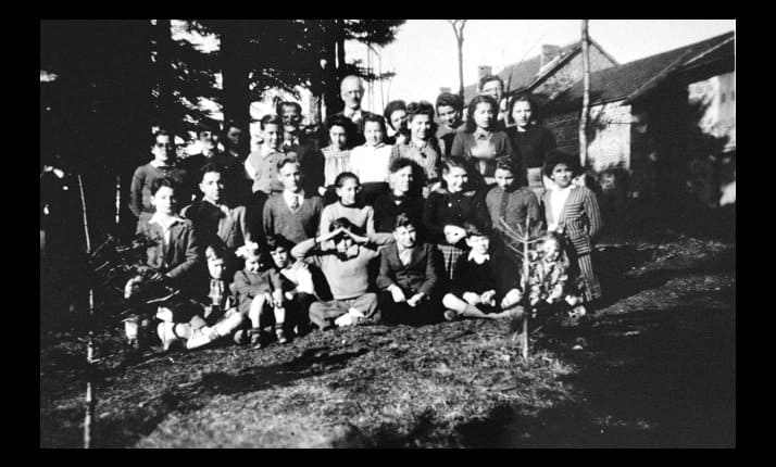 Jewish and non-Jewish children hidden at Le Chambon sur Lignon, France, pictured with their carers 1943