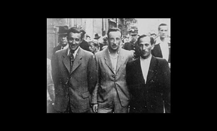 These three men took part in the Treblinka uprising and survived the war. They are pictured walking through Warsaw after the war.