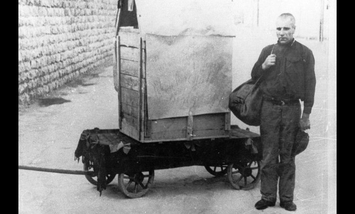 This prisoner of Mauthausen concentration camp was forced to pose, by the SS , next to the box he had used for an escape attempt.