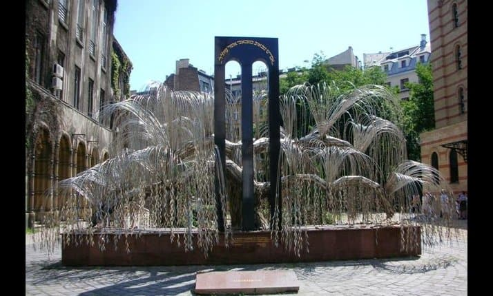 This Holocaust memorial resembles a weeping willow and is sited in Budapest, Hungary. The metal leaves bear the names of Hungarian Jews who perished in the Holocaust. The inscription on top of the memorial reads: