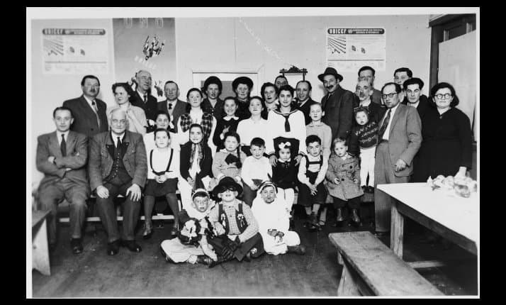 Survivors celebrate the festival of Purim at Wels displaced persons' camp, Austria.