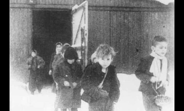 Soon after liberation, surviving children of Auschwitz walk out of their barracks, January 1945.