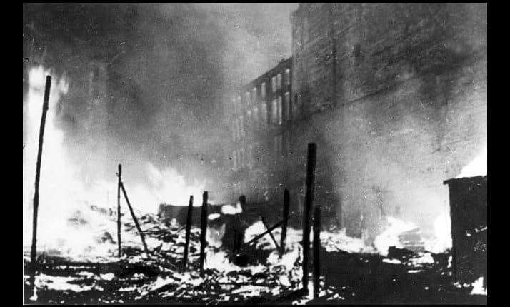 The German army set fire to buildings as they sought to clear the Warsaw ghetto street-by-street, 12 May 1943