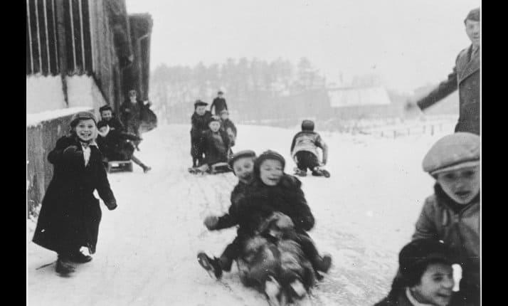 Children sledging at Ulm displaced persons camp, Germany