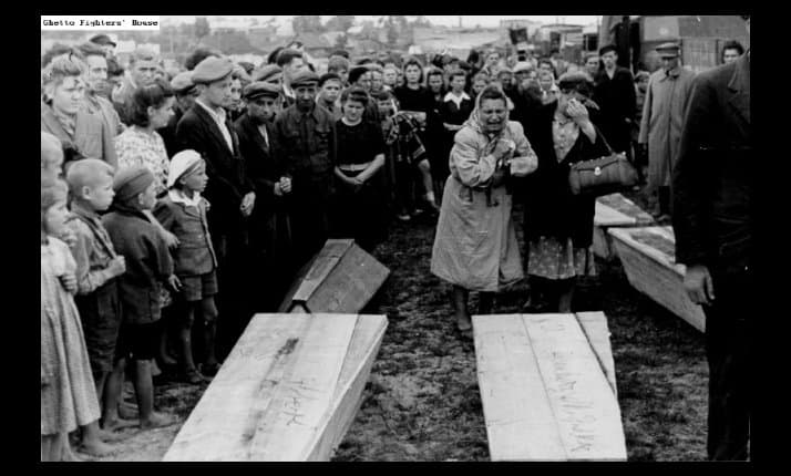 Holocaust survivors who returned to their homes in Kielce, Poland after the war prepare to bury their relatives who had been murdered by their neighbours during the pogrom of July 1946
