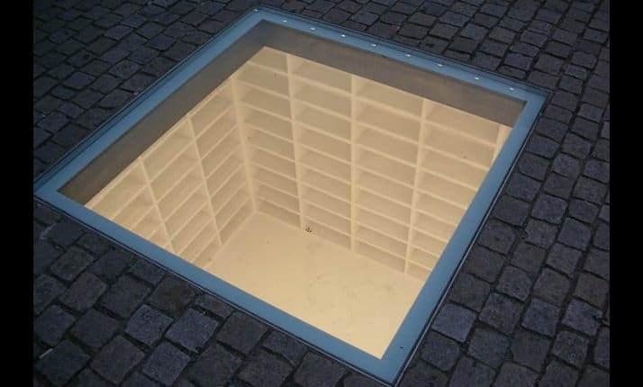 Bebelplatz memorial to the May 10, 1933 Nazi book burning, Berlin, Germany. (See below for detailed explanation) © Caroline Slifkin