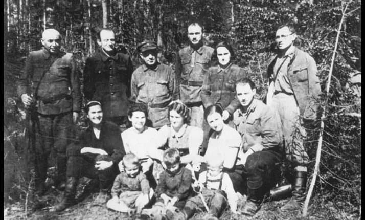 Members of the Bielski family at their camp in the Naliboki forest, Belarus, May 1944.