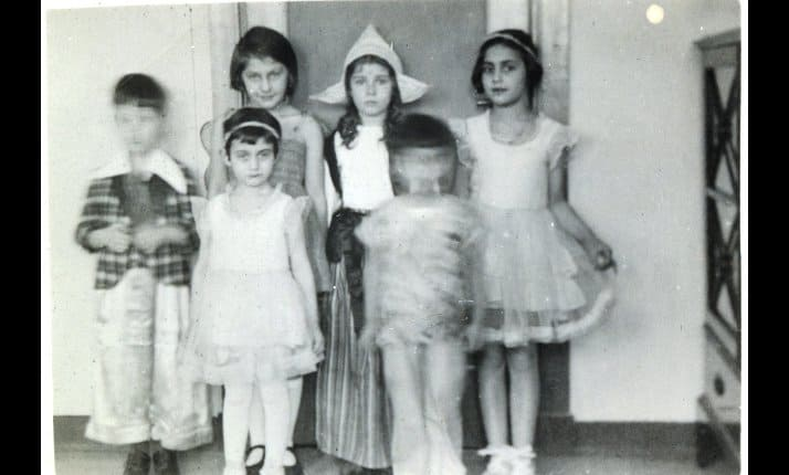 Anne Frank (front left) celebrated Purim with her friends in 1934