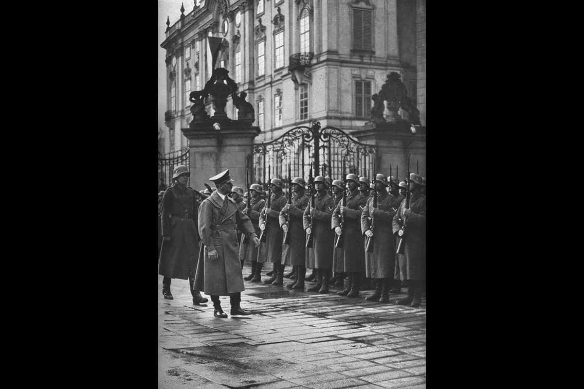 Hitler inspects troops in front of Prague castle in early 1939, where he had just occupied Czechslovakia and proclaimed the Protectorate of Bohemia and Moravia.