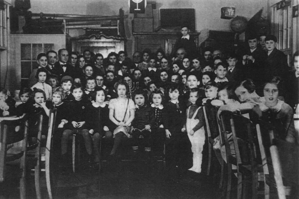 Men, women and children gather at a Chanukah celebration in 1938.