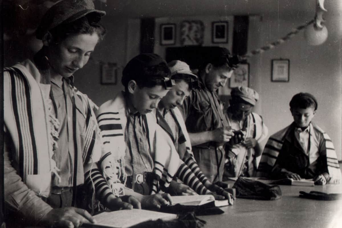 Children wearing Tallit's at the Jewish children's home 'Ohel David' in post-war Slovakia.