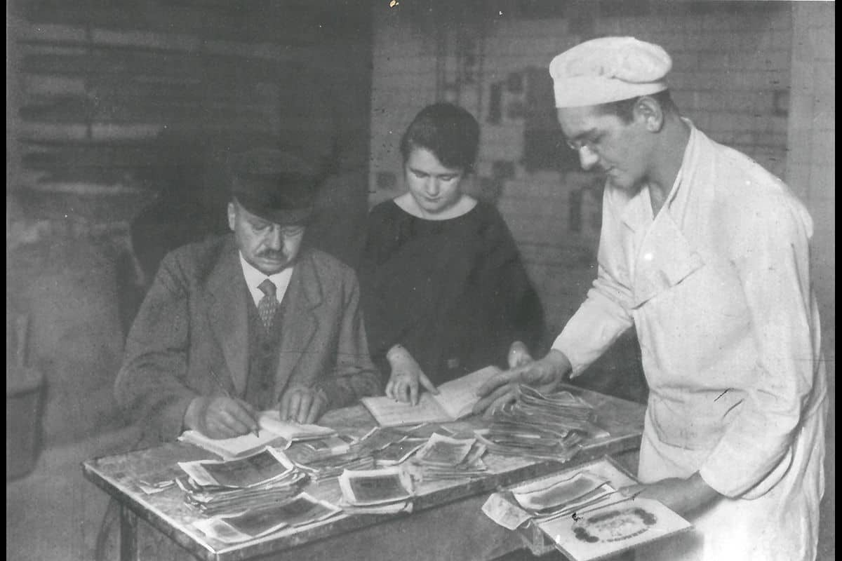 A group of workers in a bakery count stacks of Reichmark notes in the midst of the hyperinflation.