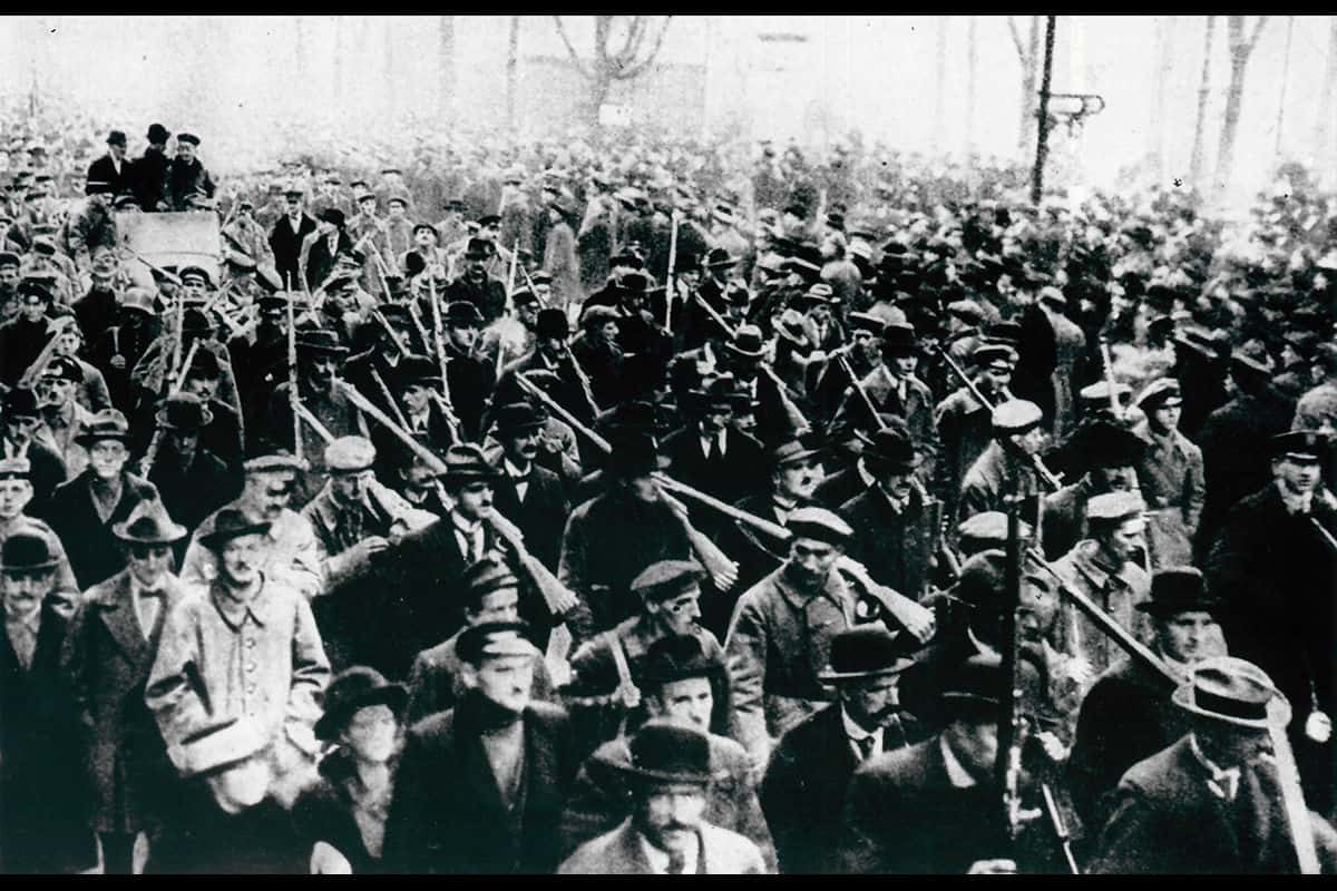Revolutions were stirring in many of Germany's cities towards the end of 1918. Here, crowds descended to the streets of Berlin to support Emil Eichhorn. Eichhorn was the Police Chief of Berlin until his dismissal following his refusal to act against the demonstrating workers of Berlin. He called for a demonstration, and masses attended. Many of the demonstrators were armed.