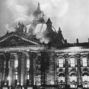 <p>On 27 February 1933, the Reichstag building burned down. A Dutch communist, Van der Lubbe, was arrested for the crime.</p>