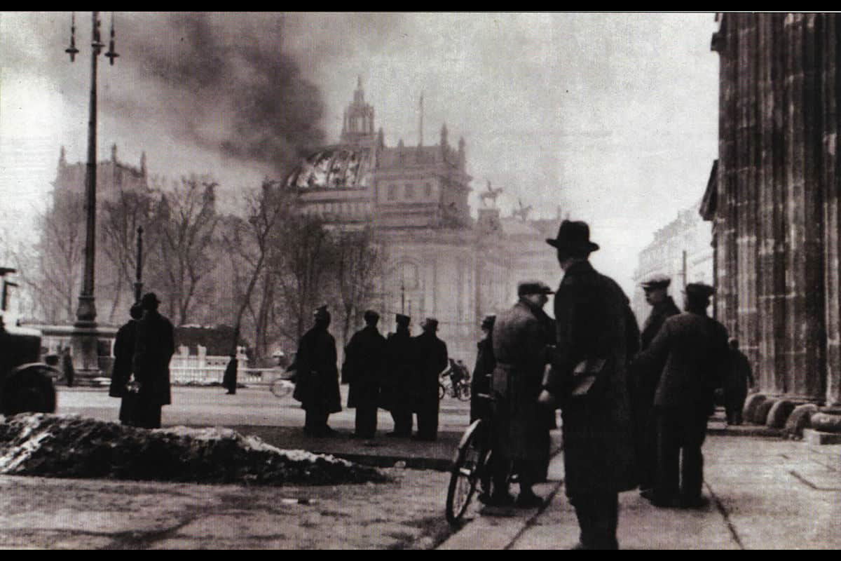 The day after the Reichstag fire, the 28 February 1933, Hindenburg signed a decree giving Hitler emergency powers. This photograph was taken the same day, showing the Reichstag still burning.