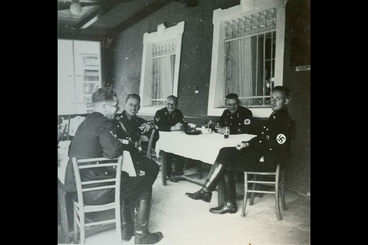 Hitler established the Schutzstaffel or SS in 1925. They soon became essential to the Nazi Party. Here a group of SS men are pictured sitting at a table in their recognisable black uniform in the early 1940's.