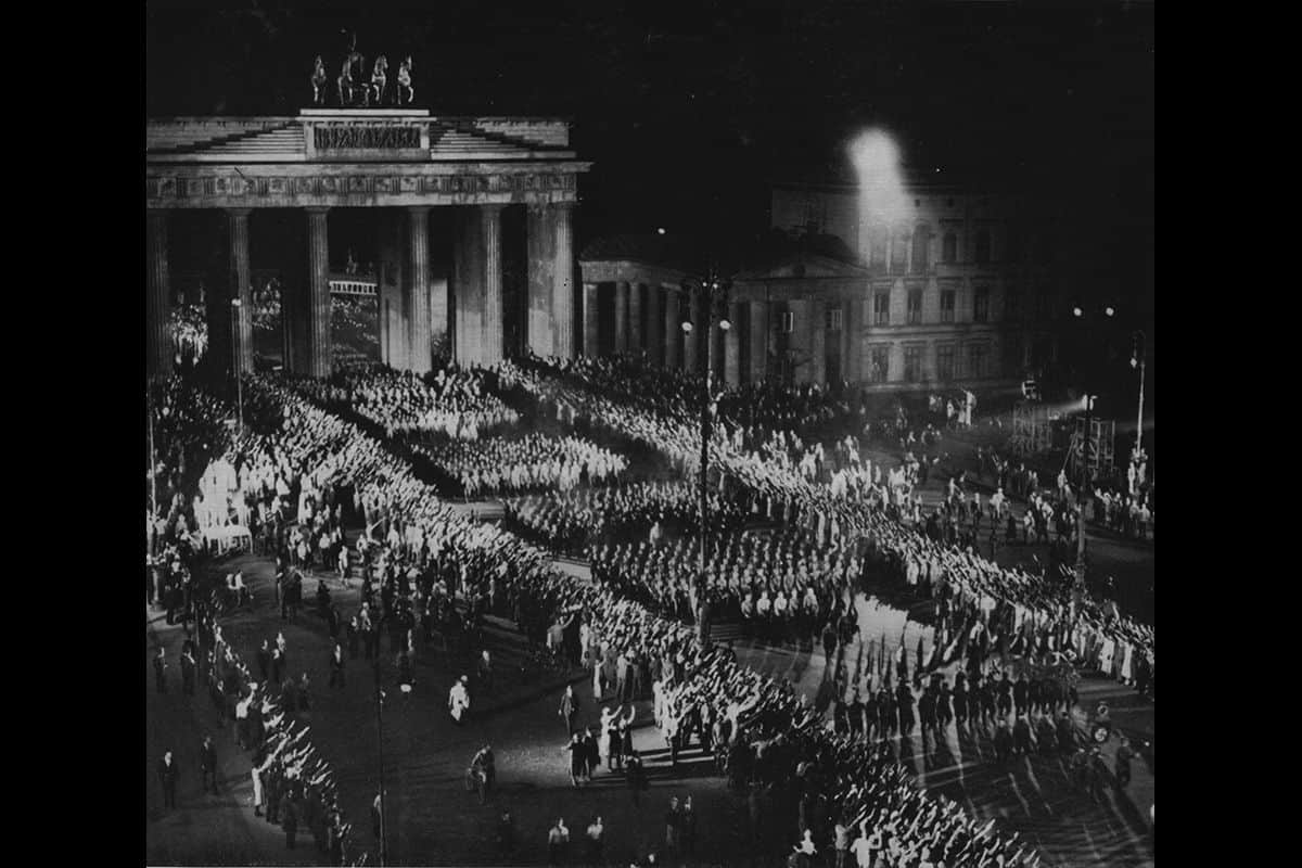 On the 30 January 1933 Hitler was appointed as chancellor of the Weimar Republic. This photograph shows the SA as they marched victoriously through the Brandenburg Gate in Berlin the same day.