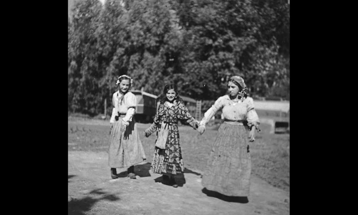 Three young Roma women walk together along a road in 1930s Europe. Roma were judged to be racially 'undesirable' and therefore were also highly persecuted under Nazi rule.