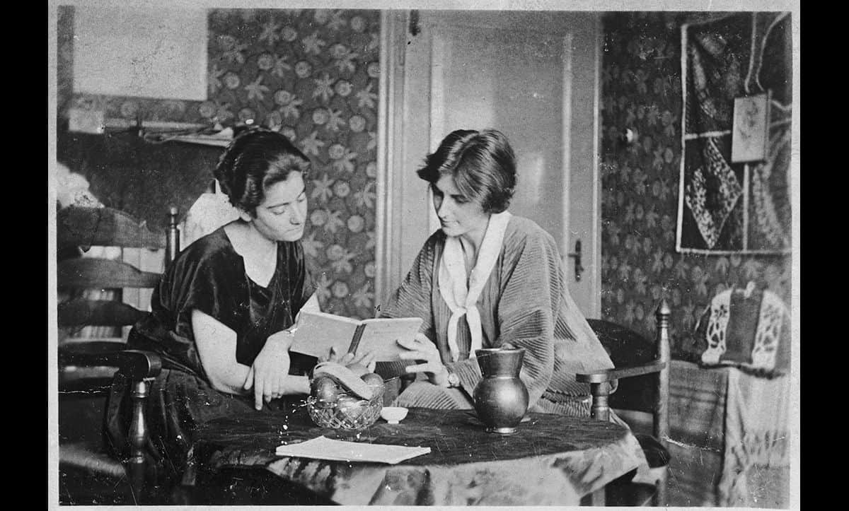 Frieda Belinfante with her partner Henriette Bosmans in their apartment in the late 1920s. Frieda was a Jewish cellist and conductor from Amsterdam who was openly lesbian from the age of sixteen. Following the Nazi invasion of the Netherlands, Frieda worked for the gay resistance group the CKC, arranging for false papers for those persecuted and hunted by the Nazis.