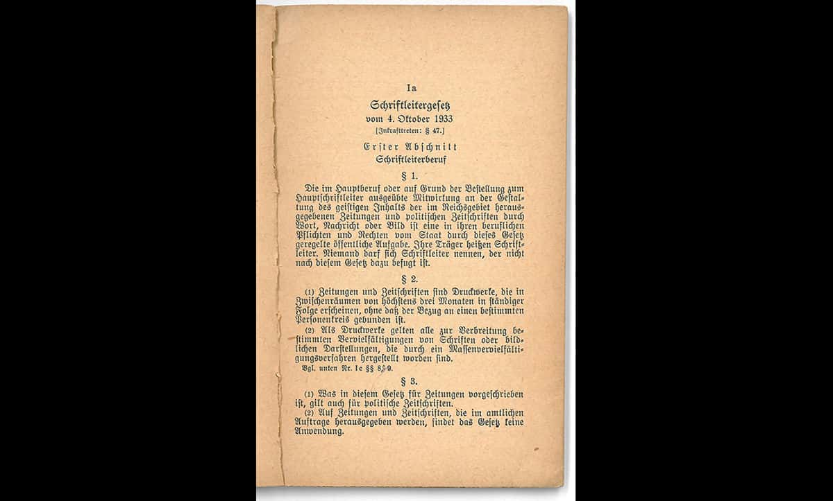 The Editorship Law, a copy of which shown in the image here, was passed on the 4 October 1933.  This law stated that all editors must be 'Aryan', dismissing hundreds of 'non-Aryan' Jewish editors on purely racial grounds.