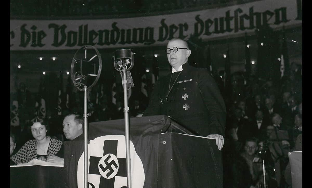 Ludwig Müller, pictured here giving a speech at a Nazi event, was the leader of the Reich Church. The Reich Church was founded by the Nazis with the support of 'German Christians', protestant supporters of the Nazi Party who had been hostile to the Weimar Republic.