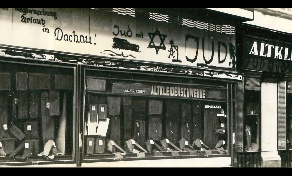 Following Kristallnacht, antisemitism in Germany intensified further. This shop had 'On holiday in Dachau' painted onto the front, referring to the owners arrest and deportation to the concentration camp Dachau.
