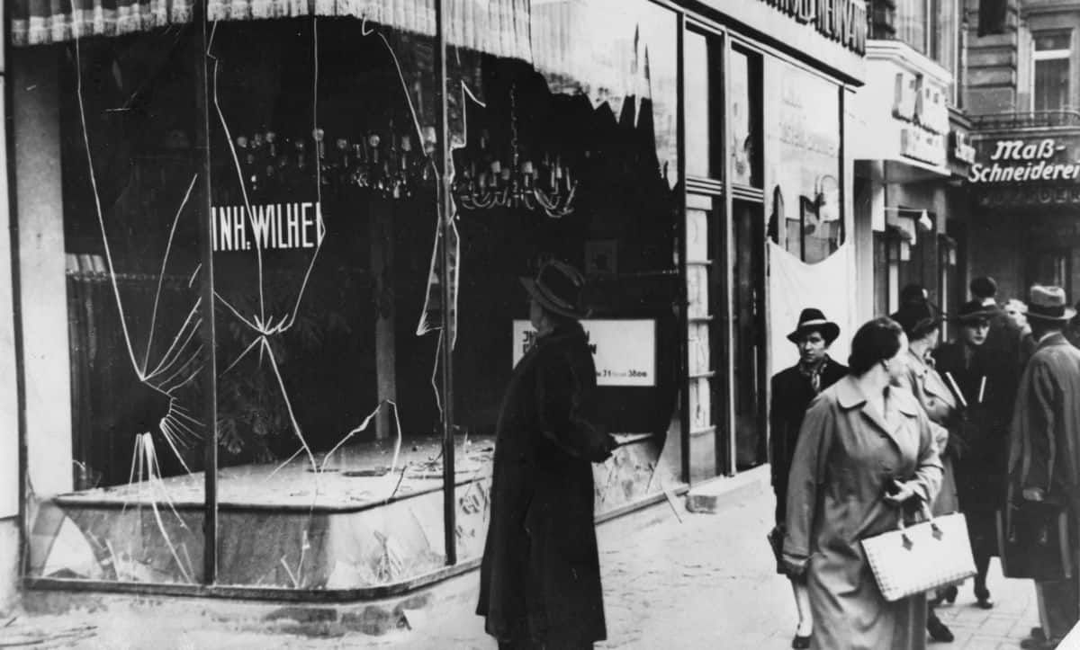 One of the defining features of the Nazis' regime was their apparatus of terror. This image shows the devastation of Kristallnacht, an antisemitic pogrom which took place in November 1938. Over the course of this pogrom alone, over 25,000 people were sent to concentration camps, over 7,500 businesses had their windows smashed, over 1,000 synagogues were destroyed and just under 100 people were murdered.