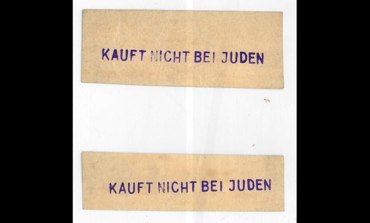 These labels translate to say 'Do not buy from Jews'. Whilst their exact provenance is unknown, it is likely that these labels were handed out to encourage the boycott of Jewish shops and businesses.
