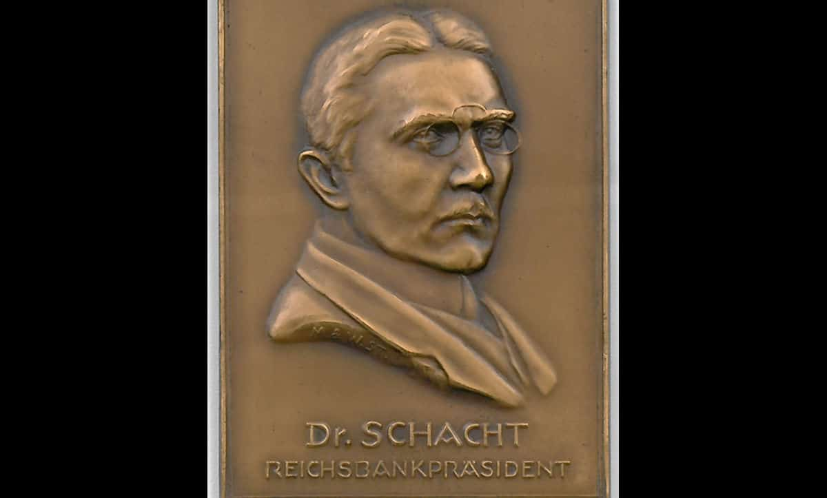 A small metal plaque showing Hjalmar Schacht as President of the Reichsbank. This plaque comes from the Robinson family collection who, prior to Kristallnacht, owned a large fashion store in Hamburg. The plaque helps to evidence Schacht's popularity in Germany at the time of his appointment.