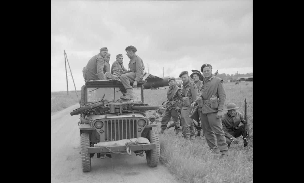 British troops with captured German soldiers near Ranville on the evening of the 6 June 1944.