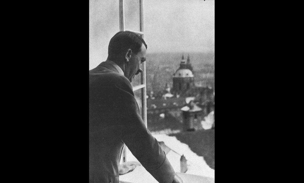 Just six months after agreeing the Munich Pact, Hitler invaded and occupied the rest of Czechoslovakia. Here, Hitler is pictured looking out of a window of the occupied Prague Castle in March 1939.
