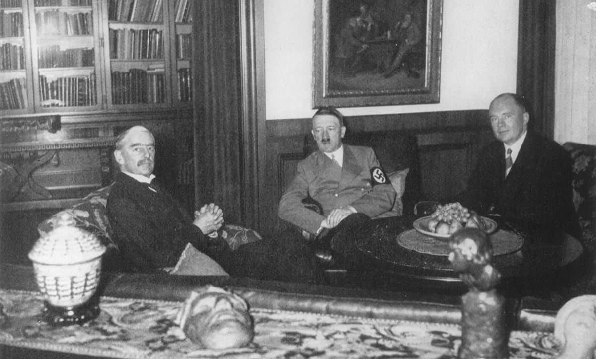 From the 29 – 30 September 1938, the British, French, Italian and German leaders met in Munich to discuss Hitler's demands for the Sudetenland. This photograph of the British Prime Minister, Neville Chamberlain, was taken following talks in Hitler's apartment on the 30 September 1938.