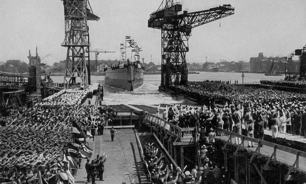 Following the Anglo-German Naval Agreement in 1935, Germany expanded the number of warships produced. This photograph was taken at the launch of armour-plated vessel Admiral Graf Spee, which officially joined the German fleet on the 6 January 1936. The Admiral Graf Spee was used in the Spanish Civil War, before being sunk by the British at the start of the Second World War in 1939.