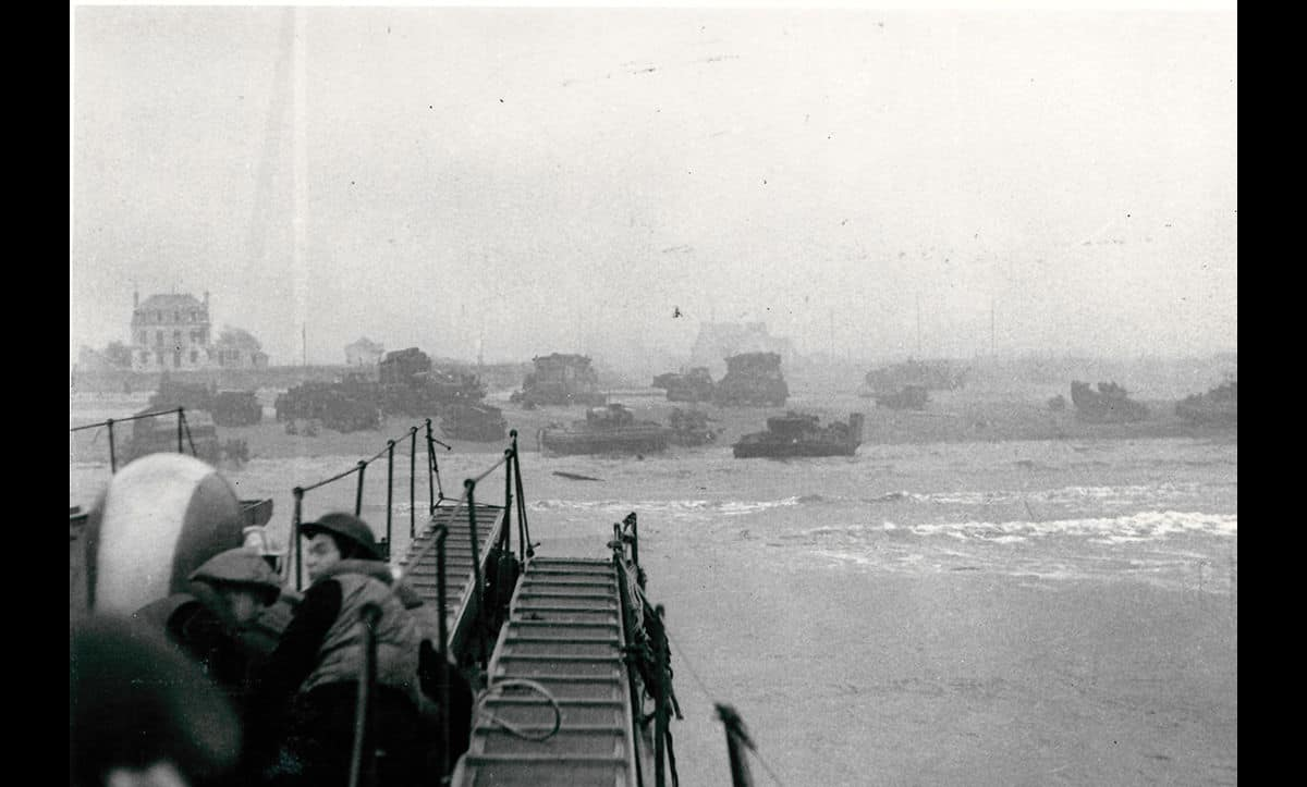 Ships carrying Allied troops start to land on Normandy beaches during the Invasion of Normandy.