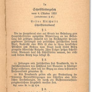 <p>On 4 October 1933, it was decreed that all editors must be 'Aryan'. Image shows a copy of the Editorship Law.</p>