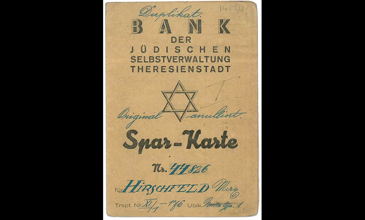 This savings book, issued by the self-administered Jewish bank of Theresienstadt, belonged to Max Hirschfeld. The book was used to record and receive pay for labour carried out in the ghetto. This pay was credited to a fake bank account and no money was received.