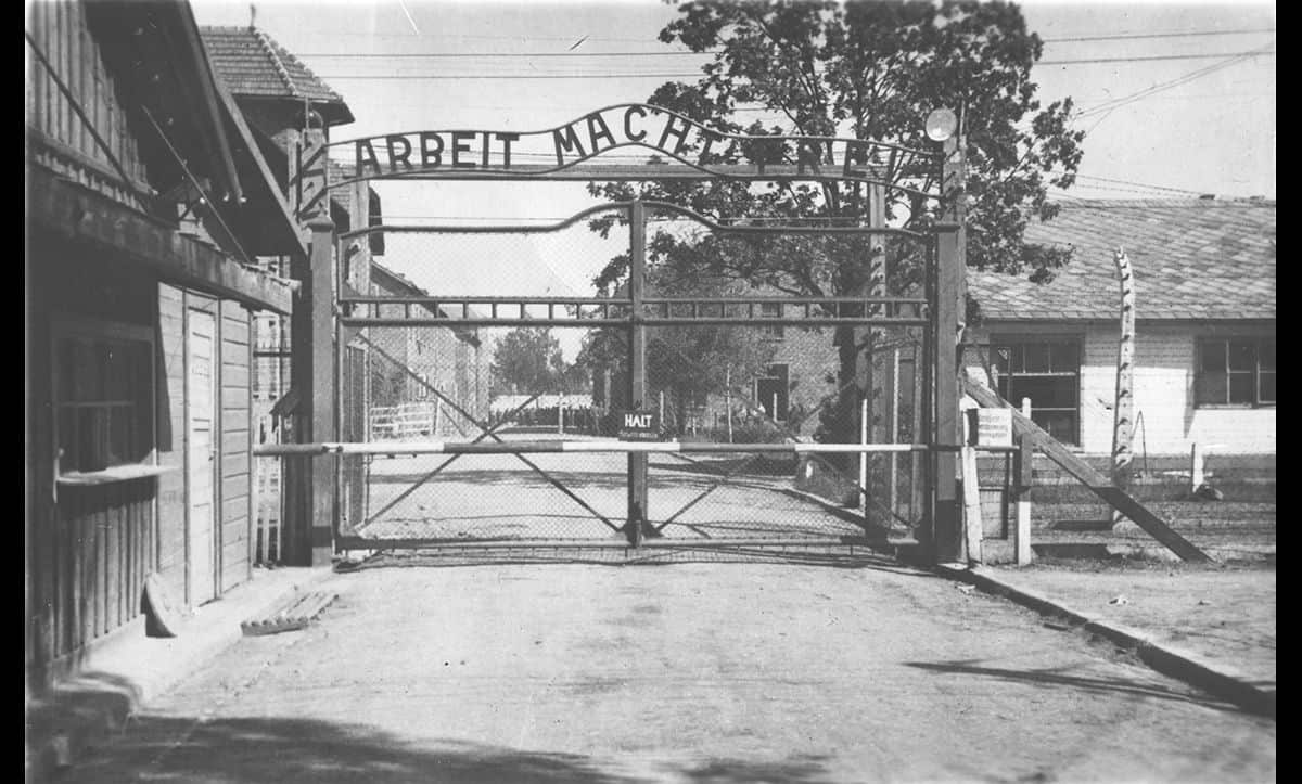 The infamous gate at Auschwitz I concentration camp, paradoxically stating 'work makes you free'. In reality, most people who entered Auschwitz would die at the hands of the Nazis.