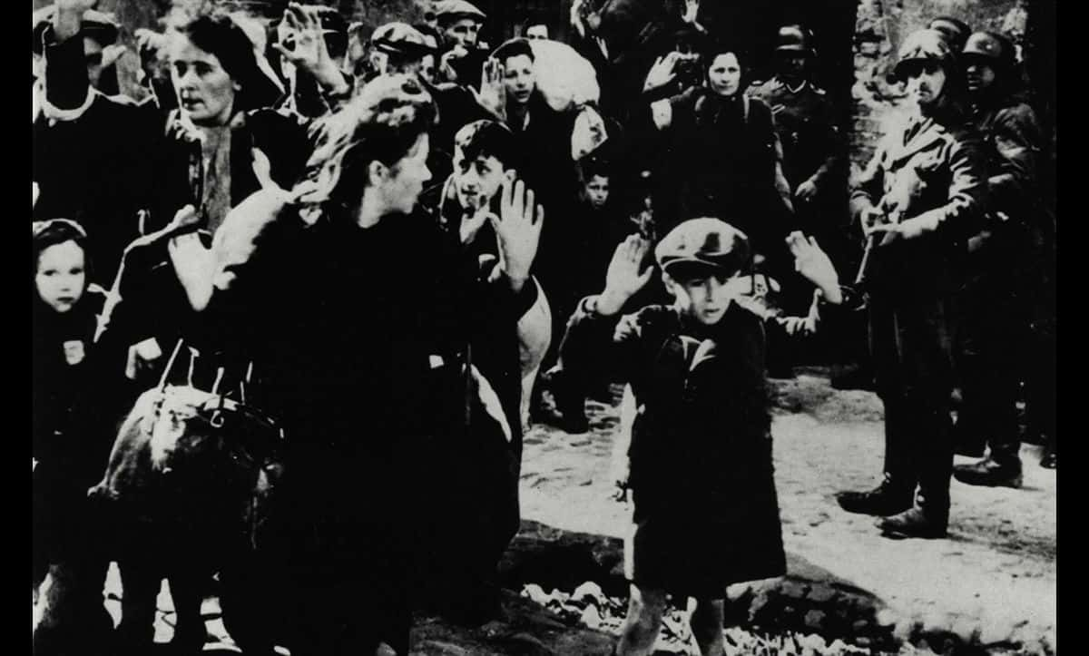 This photograph was taken as part of the Stroop Report in May 1943. It shows Jews being forcibly removed from a bunker following the Warsaw Ghetto Uprising. Following their removal, it is likely that these Jews were deported to Treblinka extermination camp and murdered.