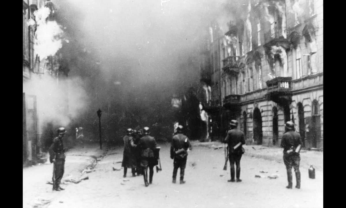 This photograph also features as part of the Stroop Report. Here, German troops are pictured sweeping through the Warsaw Ghetto in May 1943.
