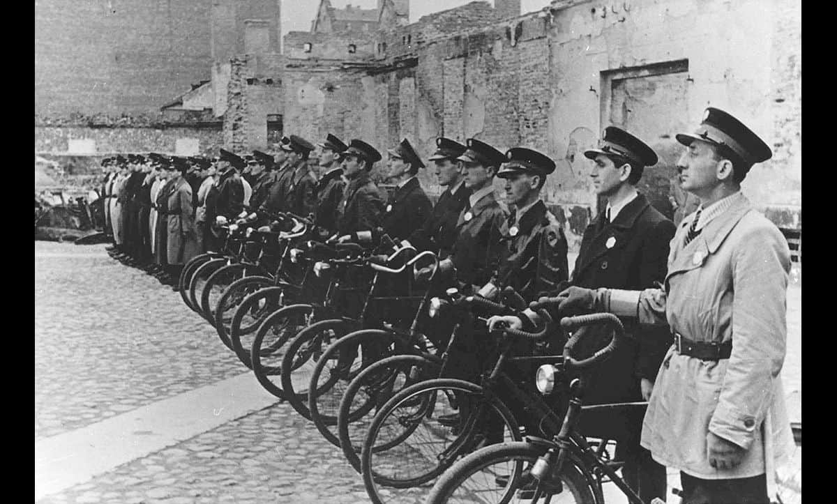 Within the ghetto, a Jewish police force was recruited to enforce order. Here, the Jewish Ghetto Police of the Warsaw Ghetto are pictured.