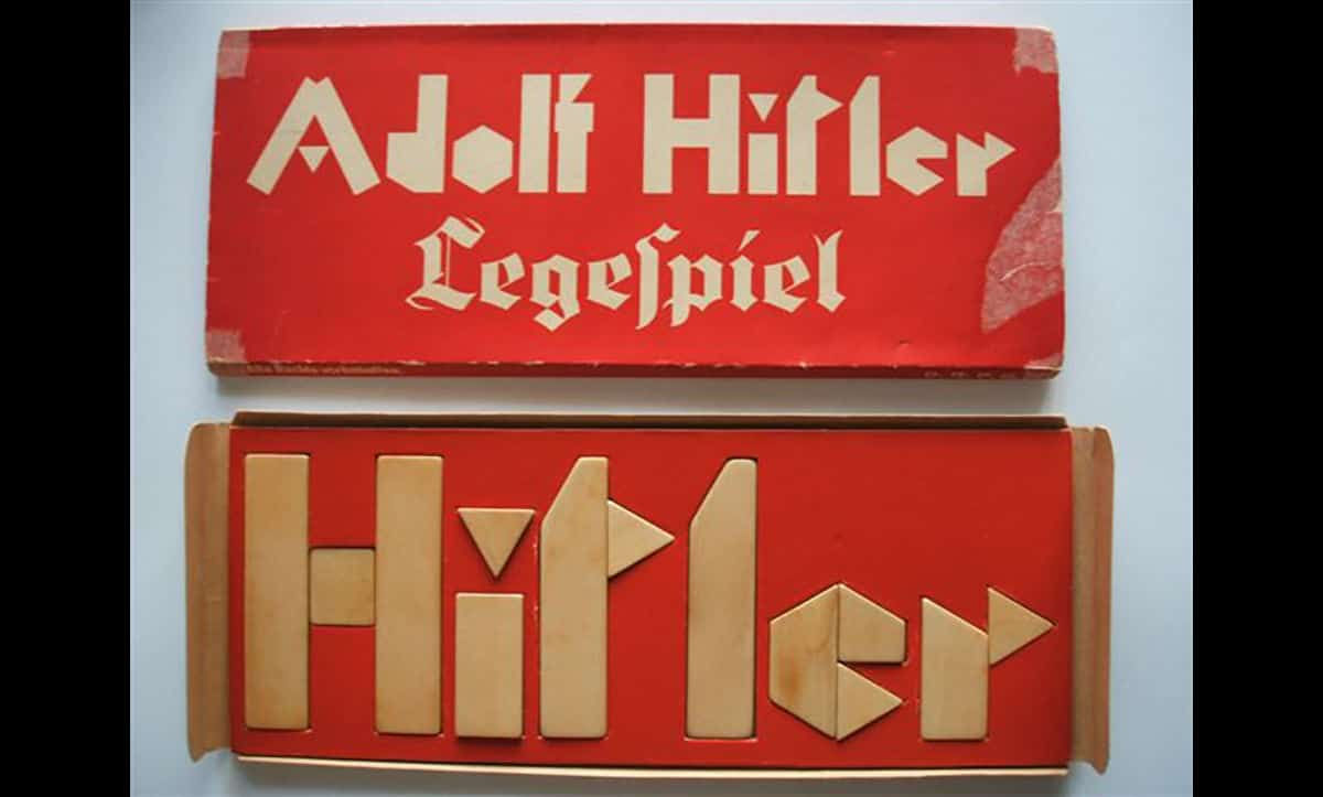 This children's game was produced in Nazi Germany. The blocks can either be arranged to spell 'Hitler' or to form a swastika.