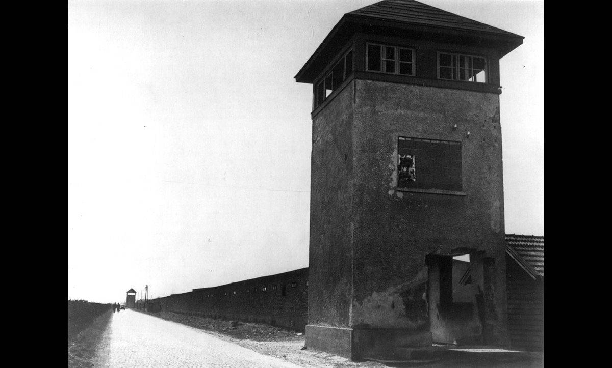 The watchtower at Dachau. Dachau was created in 1933 and was one of the first Nazi concentration camps.
