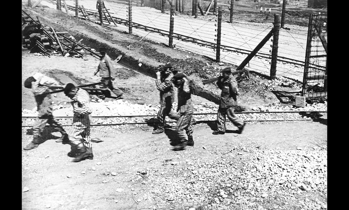 This photograph shows a group of forced labourers at work in Kraków-Płaszów camp in German-occupied Poland.