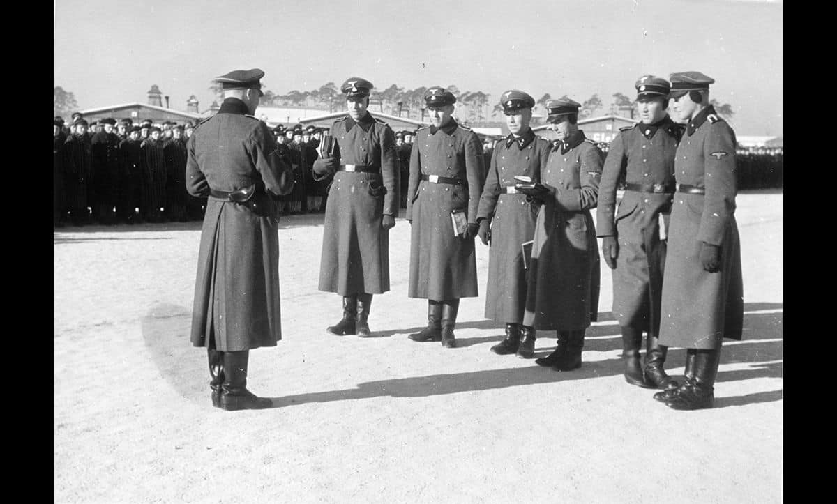 From 1934 onwards, the SS led on the administration of concentration camps. Here, SS officers inspect prisoners at roll call in Sachsenhausen in the 1930s.