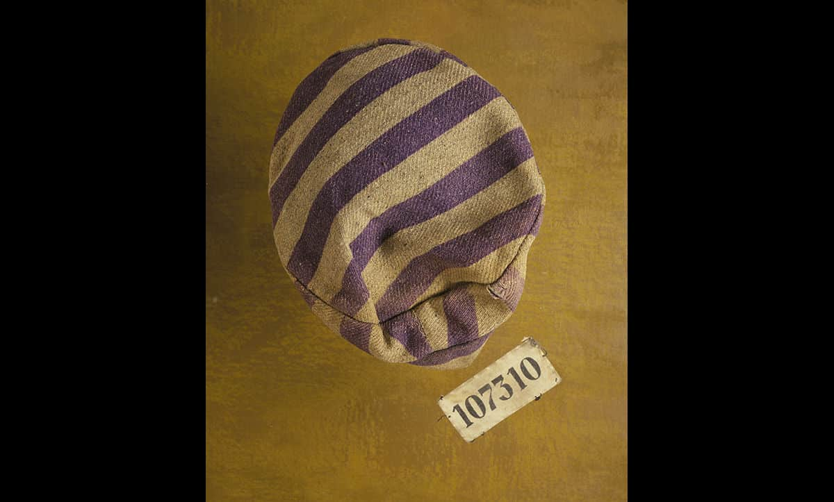 This hat was issued at Auschwitz to Charles Bruml (born Karel Bruml). Charles was first deported to Theresienstadt in 1941 and from there to Auschwitz. He later went through Gleiwitz, Nordhausen and Bergen-Belsen, where he was eventually liberated by the British in 1945.