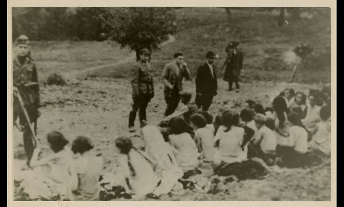 Jewish women forced to undress sit before members of the Einsatzgruppen before their execution in the early 1940s.