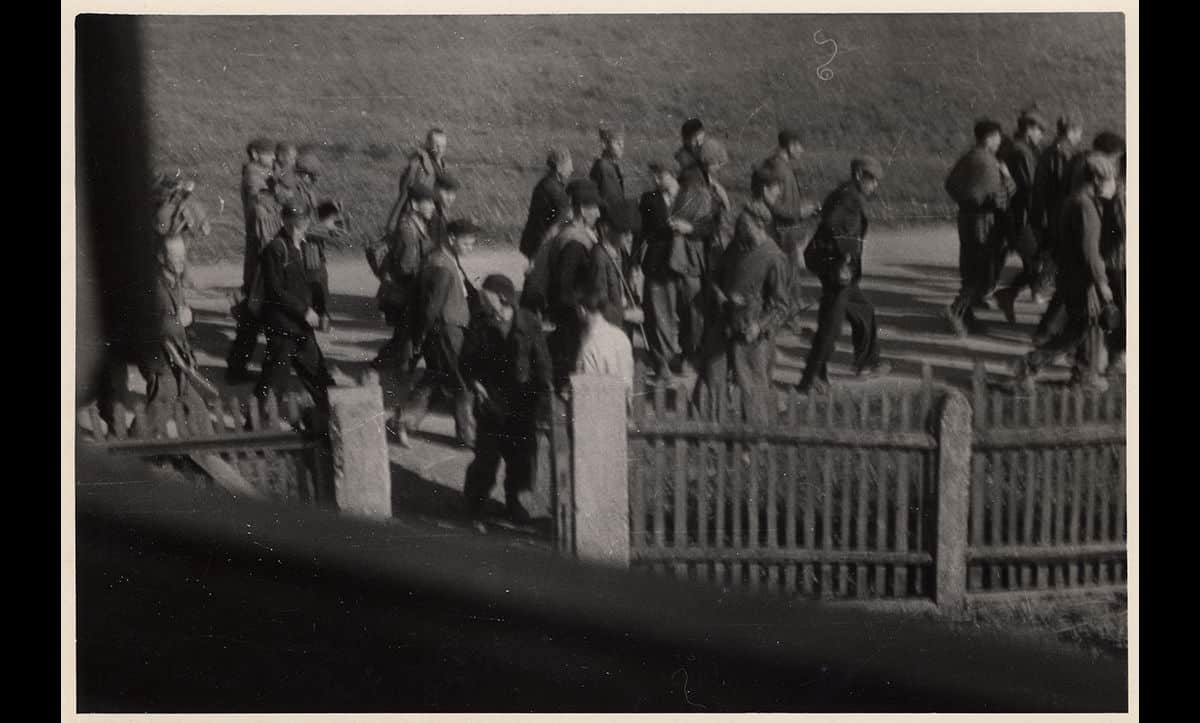 A clandestine photograph of prisoners on a death march from Nuremberg to Dachau on 26 April 1945.