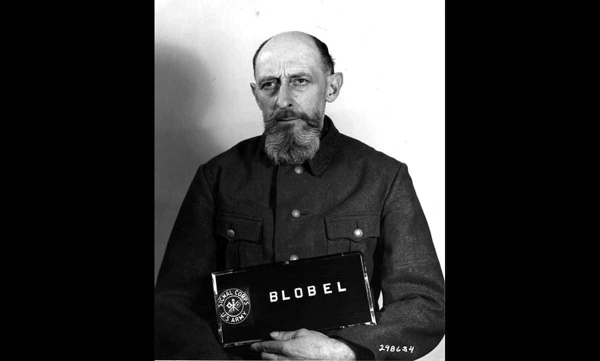 A post-war portrait of Paul Blobel taken at the Einsatzgruppen Trial in 1948. Blobel was an SS commander and a part of the Einsatzgruppen. He supervised several mass executions, including the Babi Yar massacre of 1941. After the war, he was found guilty of war crimes and crimes against humanity, and sentenced to death.